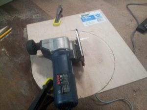 Cut a circular piece of plywood that will sit comfortably inside the top of your bucket