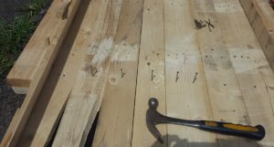 Nail the slats to the frame. I used recycled nails from the pallets I disassembled.