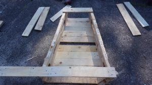 To get your next side the exact same angle, lay your legs on top of the last piece's legs, as shown. When you are happy that they are aligned, add a timber top and bottom, and use two screws on each join.