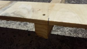 Mark a line on your timber on both sides in line with the inside edge of the legs.