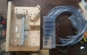 Adding some spacers, and crafting a piece to hold your 'out' pipes at different heights.