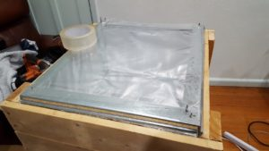 Cut your oven bag open, so it is a single layer of plastic, and attach it to you lid. Make sure there are no unsealed bits where hot air could escape.