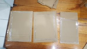 Cut rectangles for the three main sides. For added strength, tape a scrap piece of cardboard to the back of each panel.